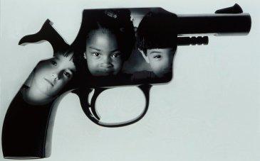Children's faces superimposed on handgun