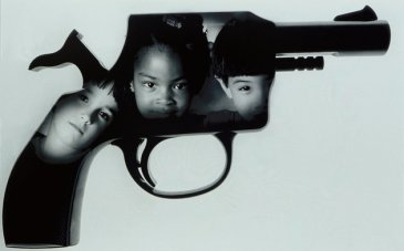 Children's faces superimposed on handgun